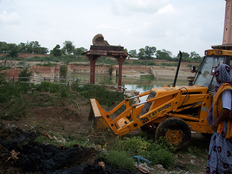 Clearing of bushes at Vrishbhanu Kund